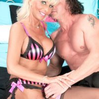 Busty blonde granny Stormy Lynne sucks a big cock in sexy lingerie and nylons
