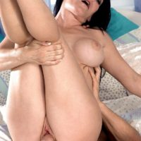 Busty mature MILF Daisy Rock fingers her shaved pussy during anal sex in heels