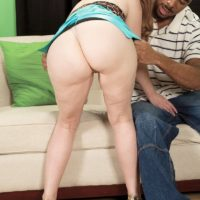 Busty mature pornstar Heather Barron shakes her big butt during interracial action on a couch