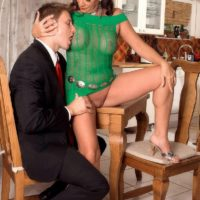 Busty mature woman Margo Sullivan seduces a younger man in a short dress