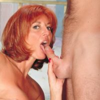Busty older redhead April receives a facial cumshot after hardcore sex with a younger man