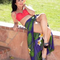 Dark haired amateur Lucky Starr makes her nude debut on a patio in high heels