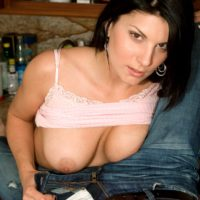 Dark haired MILF Erin Marxxx flashes her firm breasts prior to a nude POV handjob
