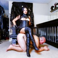Black-haired gal Michelle Lacy dominates her submissive spouse in thigh highs