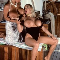 Prominent XXX film star Tawny Peaks and a lesbian gf free giant breasts from bikinis on boat