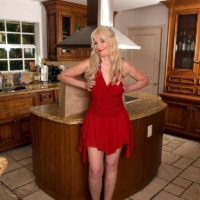 Hot blonde granny Summeran Winters seduces a younger man in a red dress