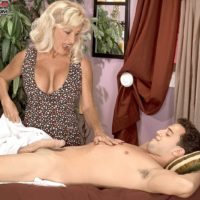 Hot older blonde masseuse Julia Butt has sexual intercourse with a young Latino boy