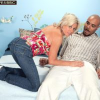 Fabulous elderly woman Payton Hall is disrobed to g-string by her junior black paramour