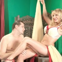 Long legged blonde granny Opal Reins seduces a young gentleman in a belly dancer outfit