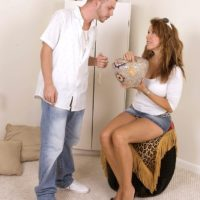 Long legged older MILF Gia Giancarlo seduces a younger guy in a denim miniskirt and heels