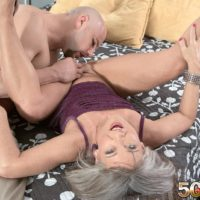 Aged woman Leilani Lei and a junior man strip each other naked upon her bed