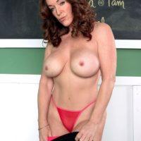 Mature MILF Rachel Steele unleashes her enhanced breasts before a POV handjob