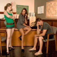 Mature redhead MILF Gia Giancarlo catches a teen girl sucking cock in a washroom