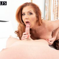 Mature redhead Mrs. Robinson sucks on the ball sac during a BJ prior to fucking