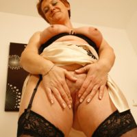 elderly redhead wife extracts her enormous all natural boobies after flashing a no panty upskirt