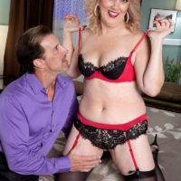 Older gal with sandy-haired hair Rebecca Williams seduces her husband in lingerie and pantyhose