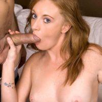 Natural redhead Gia Tyler sucks on a hard cock before parking her shaved pussy on it