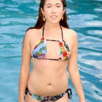 Natural redhead Goldy Lee works free of a bikini during a poolside POV handjob