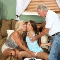 Older blonde MILF Georgette Parks treats her husband to a threesome with a teen