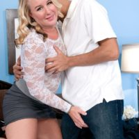 Older blonde MILF Jenna Bouche engages in foreplay while wearing a miniskirt