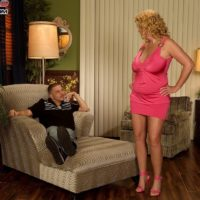 Older blonde pornstar Arowyn White sports curly blonde hair while having her nice tits played with