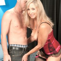 Petite blonde GILF Connie McCoy has her pussy fingered by a younger man while in sexy lingerie