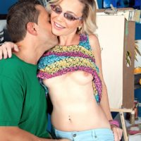 Petite mature woman Diandra has her perky little tits played with by a younger gentleman