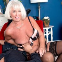 Platinum blonde GILF Jeannie Lou seduces a Latino boy in hot lingerie and hosiery