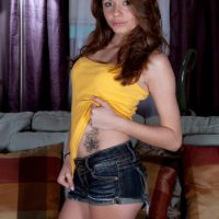 Redhead amateur Ashton Pierce reveals her tattoos as she strips naked by herself