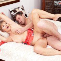 Sexy blonde granny Nicol Mandorla seduces a man with a back rub before fucking him