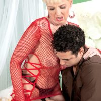 Sexy blonde granny Taylor Lynn is fondled by a young Latino boy in mesh attire over underthings