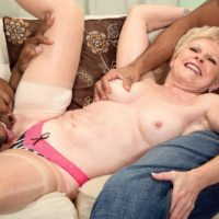 Sexy granny Jewel is stripped to thong underwear and stockings by black men