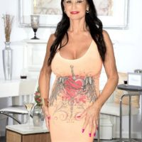 Elder adult movie star Rita Daniels unveils her large boobs and flashes undies as well