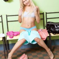 Youthful blond amateur Vanessa Staylon displays her nice butt after doing away with shorts