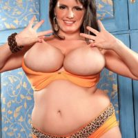 Overweight solo model Arianna Sinn displays her erect nipples after whipping out her funbags
