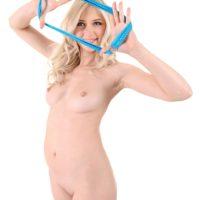Blonde solo girl Nika N peels off her bikini prior to fingering her shaved pussy