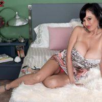 Black-haired Euro adult film star Claudia KeAloha loosing hefty boobs prior to giving handjobs