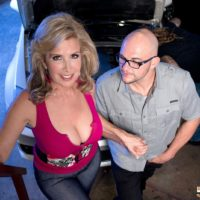 Buxom blonde cougar Laura Layne seduces mechanics for an MMF 3some in a garage