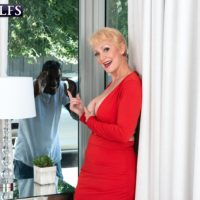 Big-boobed blonde grandmother Seka Black holds a Peeping Tom's big black penis in her hand