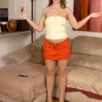 Horny teen Kalee Hunter flashes her upskirt panties on a sofa while seducing a boy