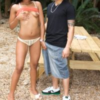 Latina amateur Emy Diaz flashes her teenie tits before outdoor sex on a picnic table