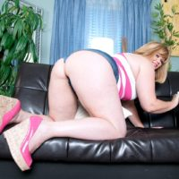 Fat solo model Marcy Diamond releasing her huge butt from denim shorts to pose naked