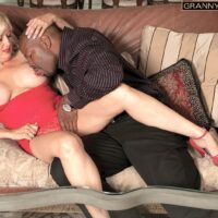 Blonde grannie Marina Johnson has her first multiracial sex experience while in a red dress