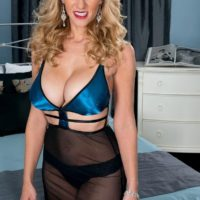 Platinum-blonde MILF Holly Claus having big breasts unsheathed for nip gobbling during foreplay