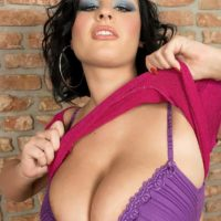 Brunette MILF Ivy Darmon sets her enormous all natural breasts loose in solo activity