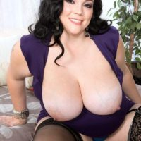 Dark-haired fatty Charlotte Angel sets her enormous titties loose of a dress and hooter holders