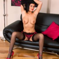 Brown-haired aged dame revealing large boobs and hot butt in hosiery and pumps