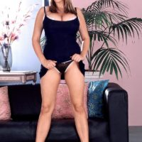 Kinky golden-haired MILF Kelly Kay flashes upskirt panties and her bum cheeks