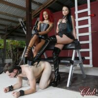 Dominatrix Daisy Ducati and her girlfriend dominate a man slave in high-heeled footwear