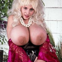 Notorious XXX flick star Lulu Devine unleashes her gigantic titties in semi-transparent stockings and garters